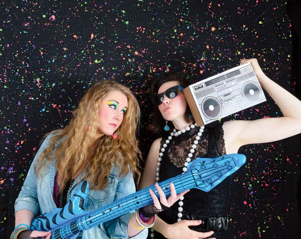 neon splatter backdrop for an 80s party photo booth
