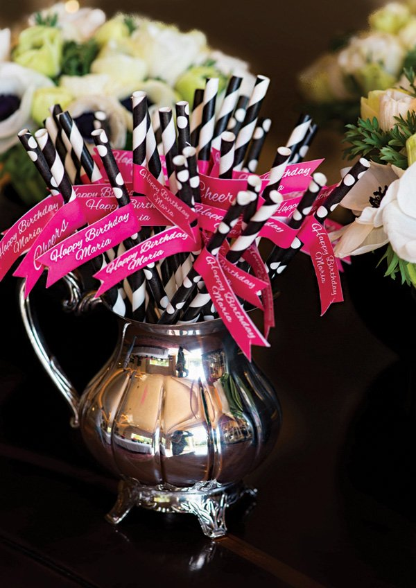 bright pink party flags and straws