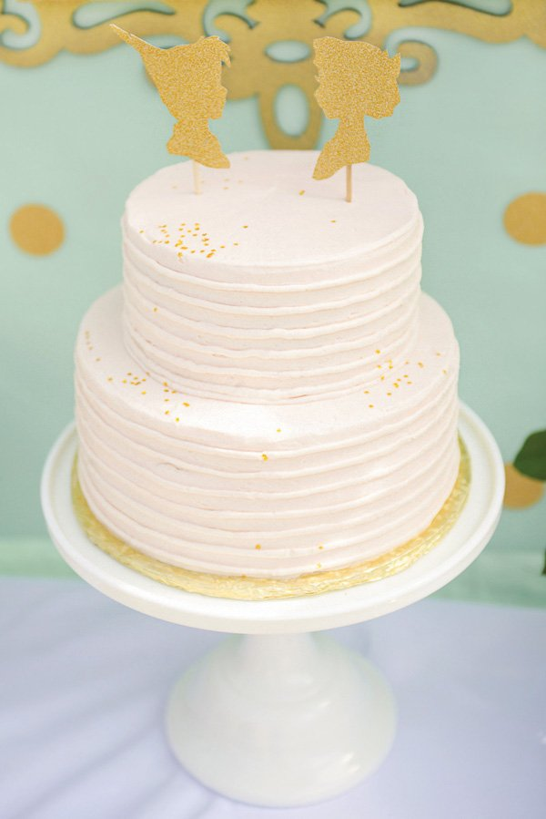 gold peter pan birthday cake
