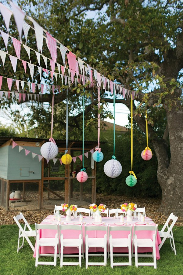 hanging honeycomb poms as floating centerpieces