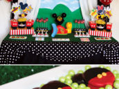 kid's mickey mouse clubhouse birthday party dessert table and chocolate covered Oreos