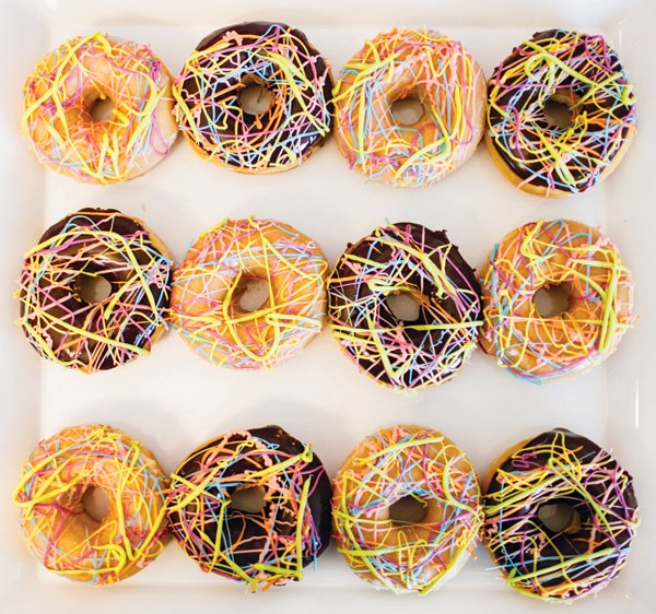 neon rainbow splattered donuts