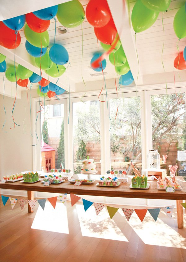 orange, green and blue dinosaur birthday party dessert table