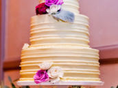 purple and pink rose decorated wedding cake