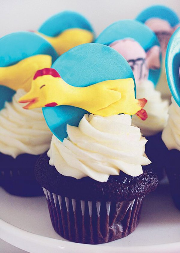 rubber chicken topped cupcakes