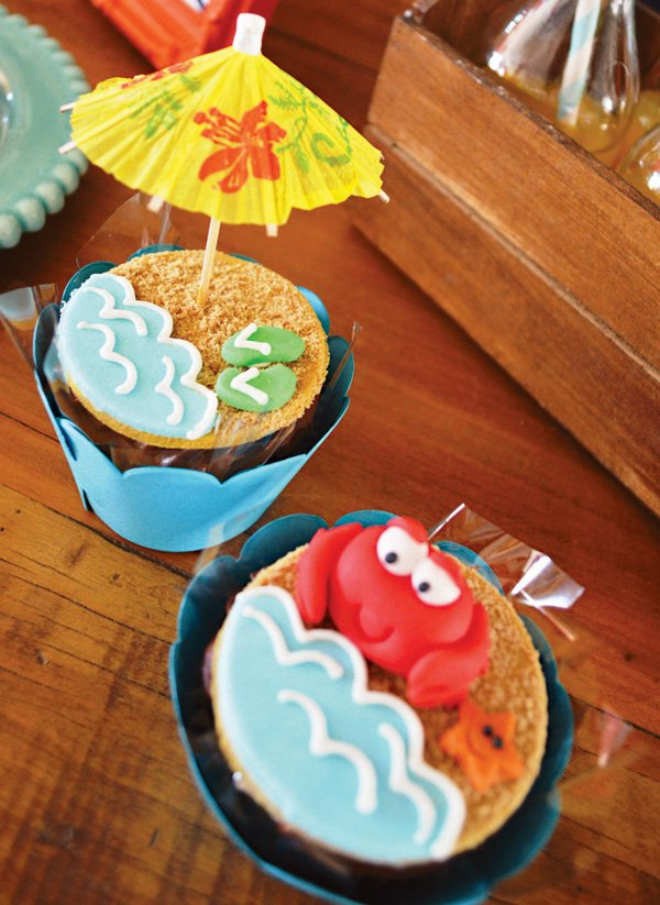 sandy crab and umbrella topped beach cupcakes