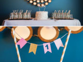 simple white first birthday cake with mini bunting topper