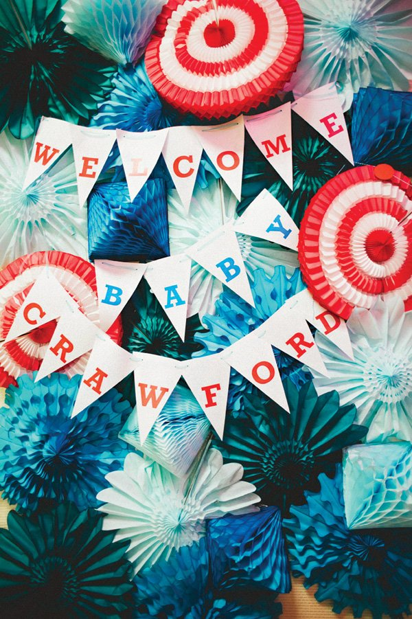 teal and red tissue pinwheel backdrop