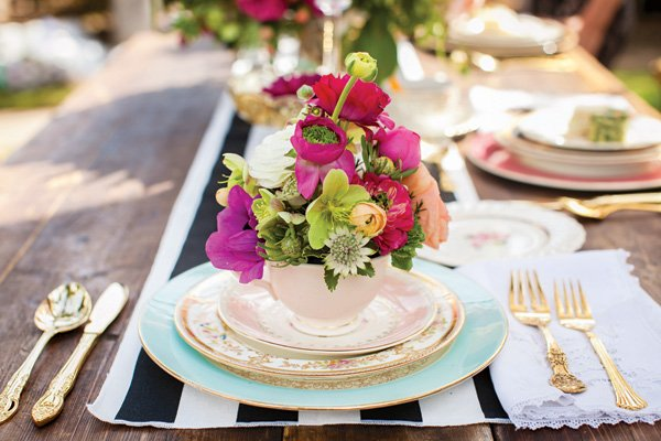 flower filled tea cup wedding centerpiece