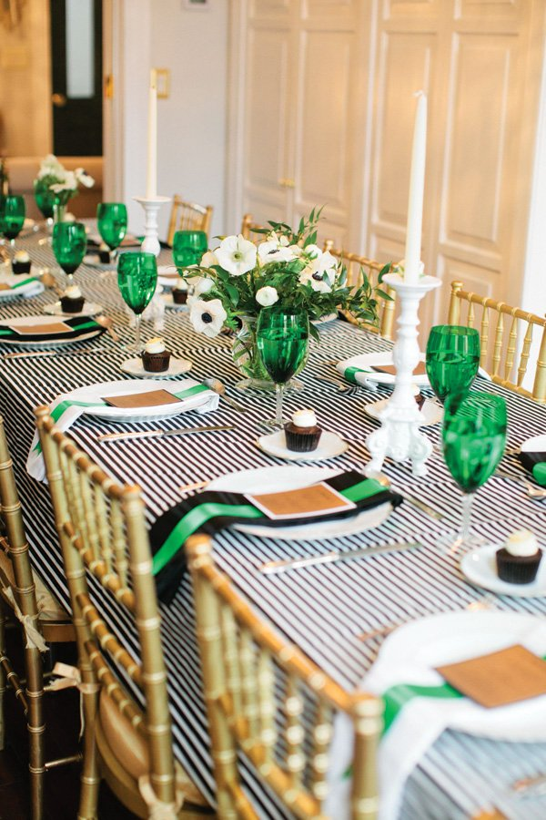 black and white striped tablescape with green accents