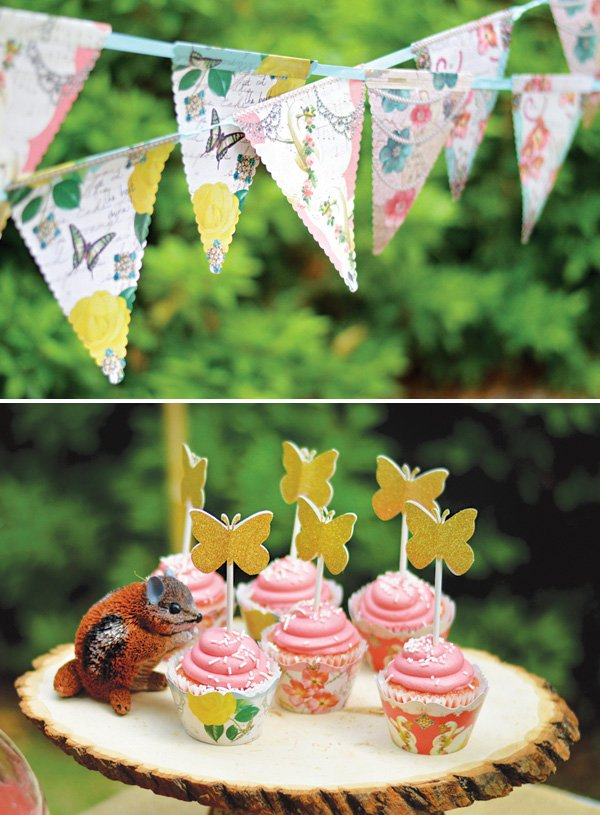 floral birthday party banner and cupcake wrappers