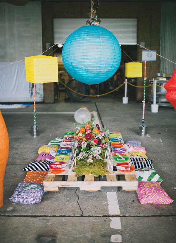 low palette kids tablescape with pillow seats