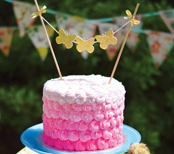 pink ombre swirl birthday cake with glitter gold butterflies