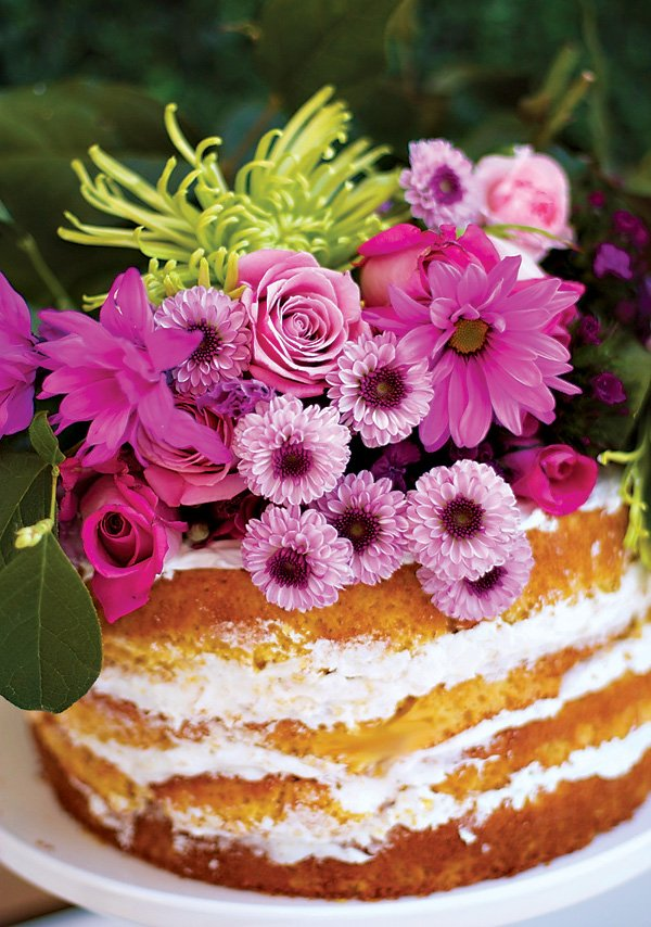 purple flower bouquet topped naked cake