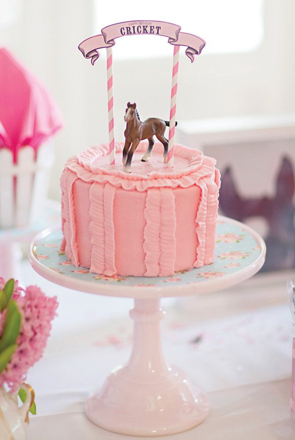 ruffled pink horse topped birthday cake