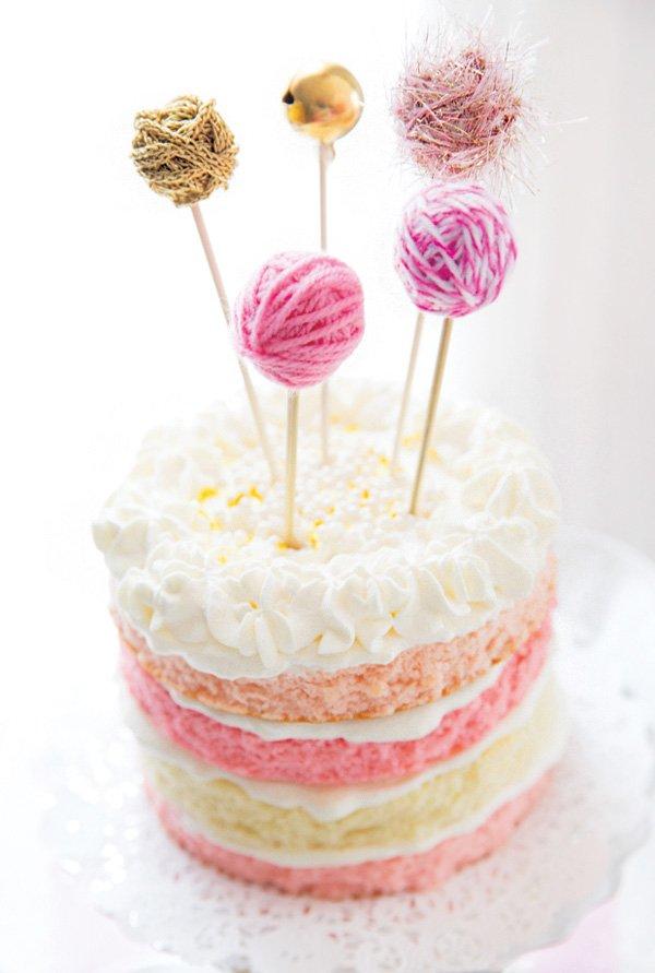 yarn ball topped birthday cake