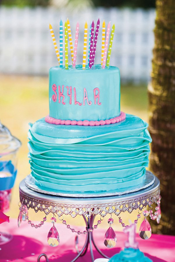 blue ruffled first birthday cake