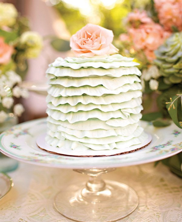 garden ruffle cake with flower topper