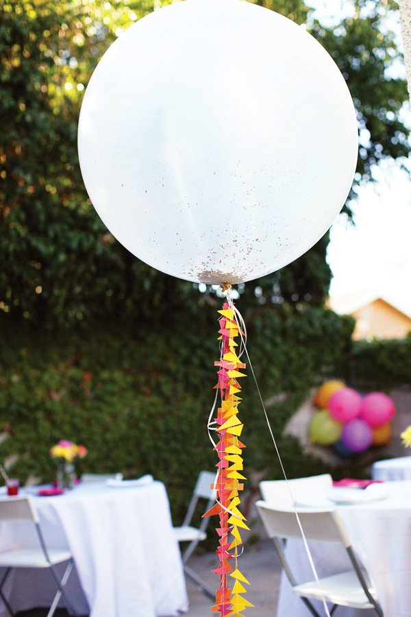 giant balloons with geometric paper tassels