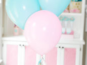pink and blue balloons with tissue tassels