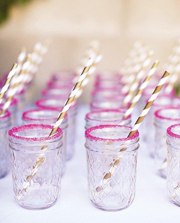 mason jars with pink sugar and gold straws