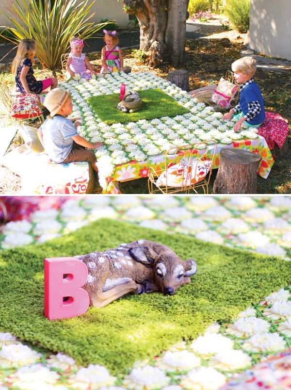 fake moss or grass and flower topped tablescape