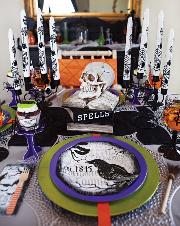spooky halloween tablescape with purple, orange and green