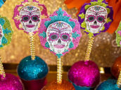 sugar skull topped candy apples