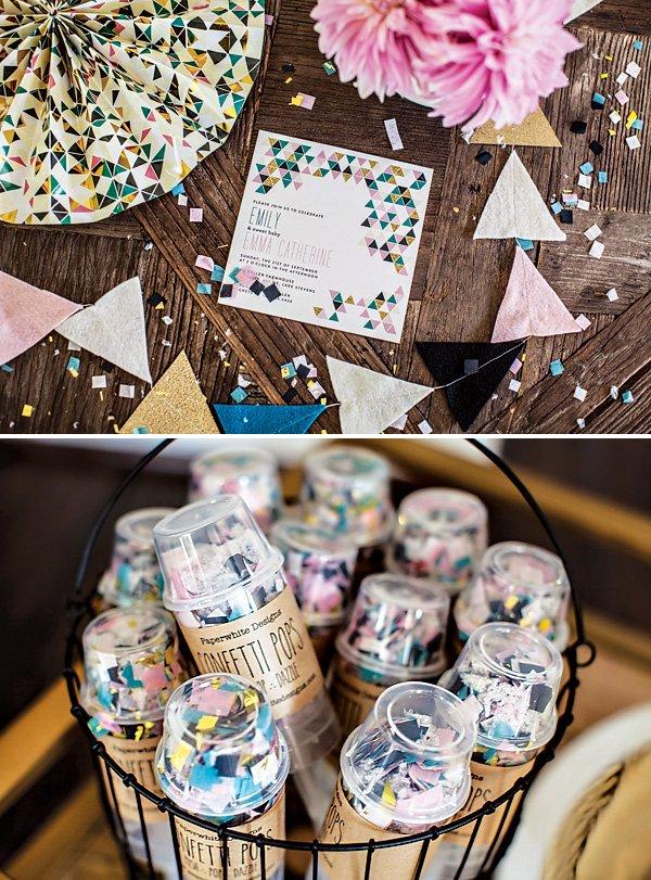 triangle confetti invitation and triangle decor for a baby shower