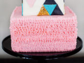 pink ruffles and triangle decorated baby shower cake