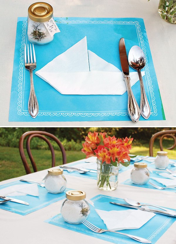 nautical baby shower table with sailboat napkins