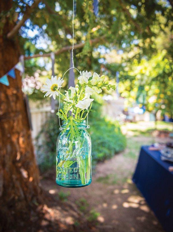 hanging blue mason jar with flowers
