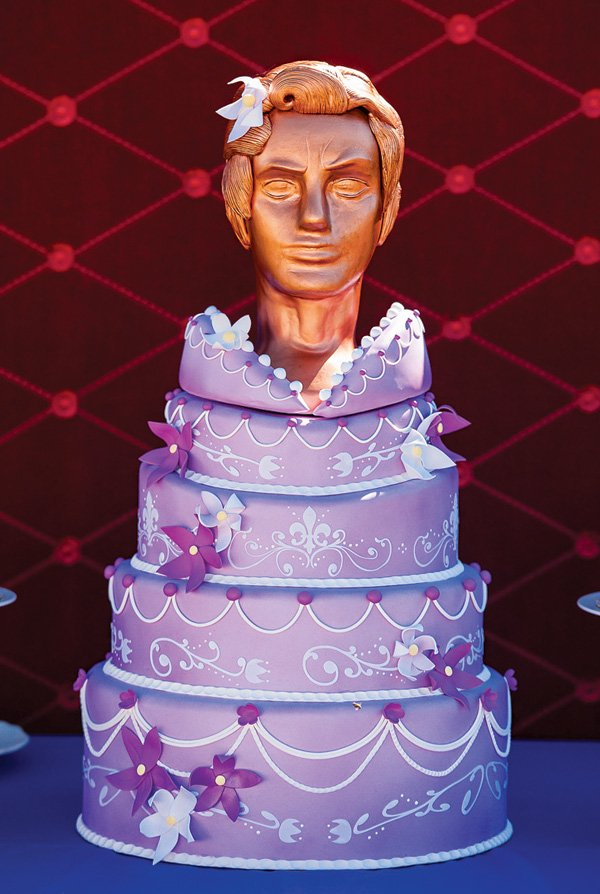 frozen coronation ball statue head topped cake