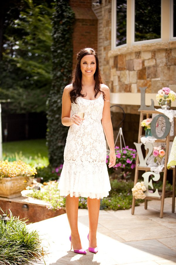bride to be in pretty lace white dress
