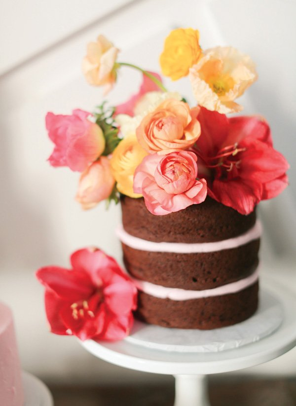 pink flower topped naked cake