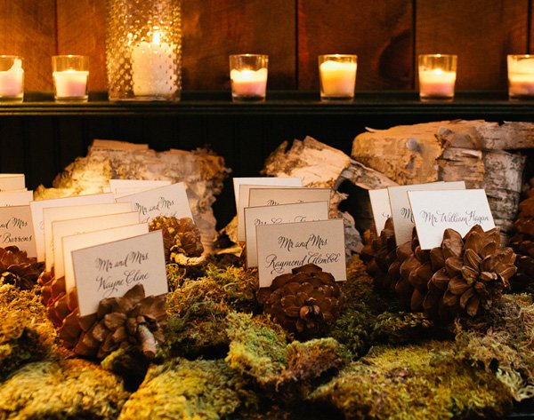 moss and pinecone place or name cards for a rustic wedding