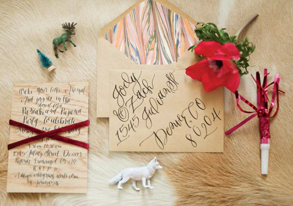 wood grain and hand-lettered birthday party invitation