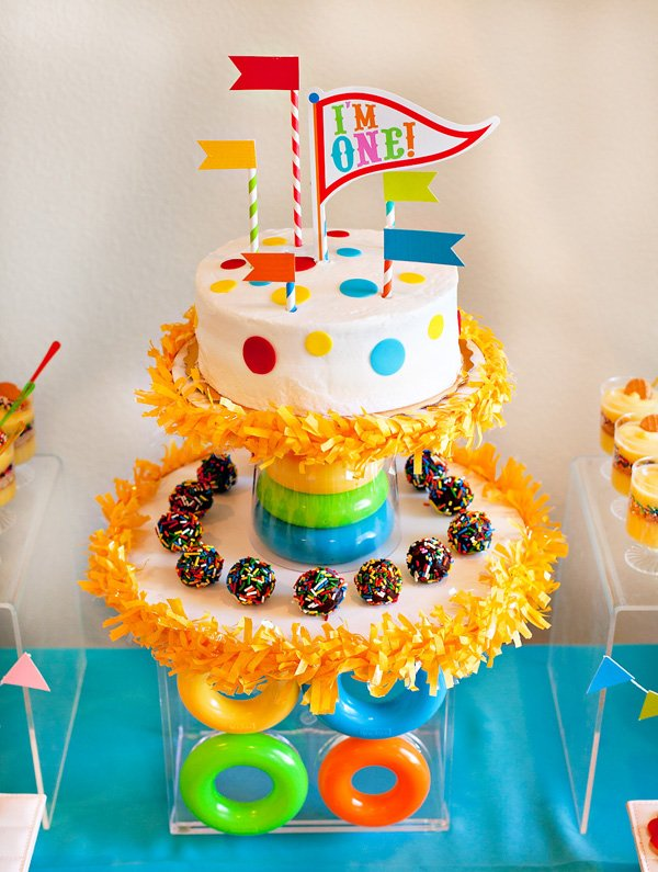 DIy circus party cake with colorful flag toppers