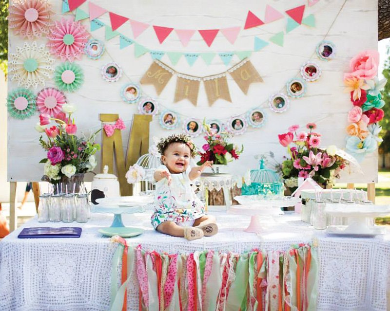 colorful first birthday party dessert table