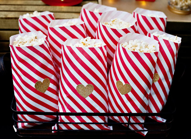 striped popcorn bags with gold glitter hearts