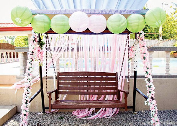 flower decorated birthday party swing