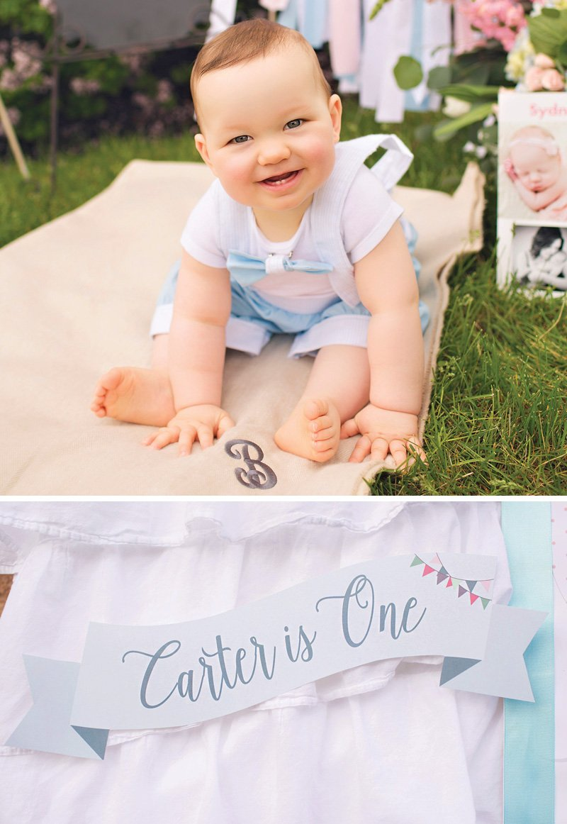 boy's blue first birthday party sign and decor