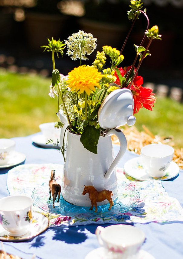 country tea party centerpiece = tea pot and flowers