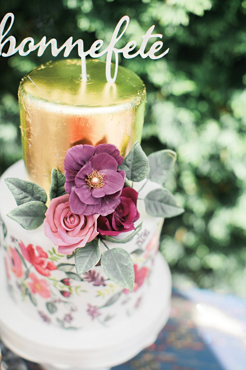floral and gold leaf birthday cake