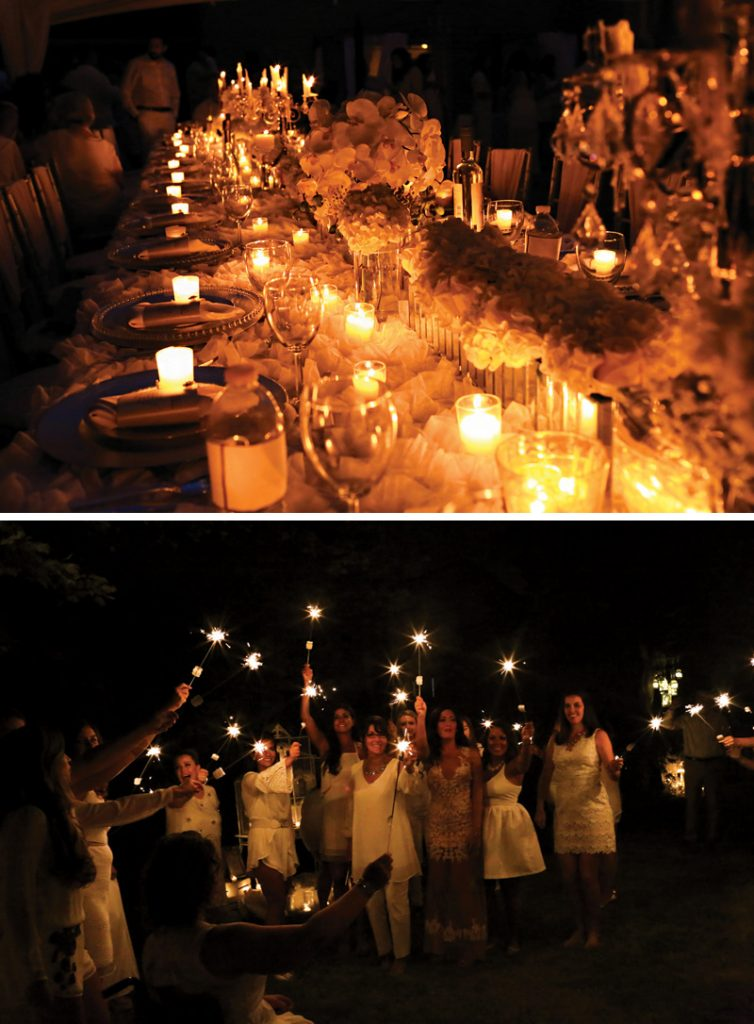 all white tablescape at night