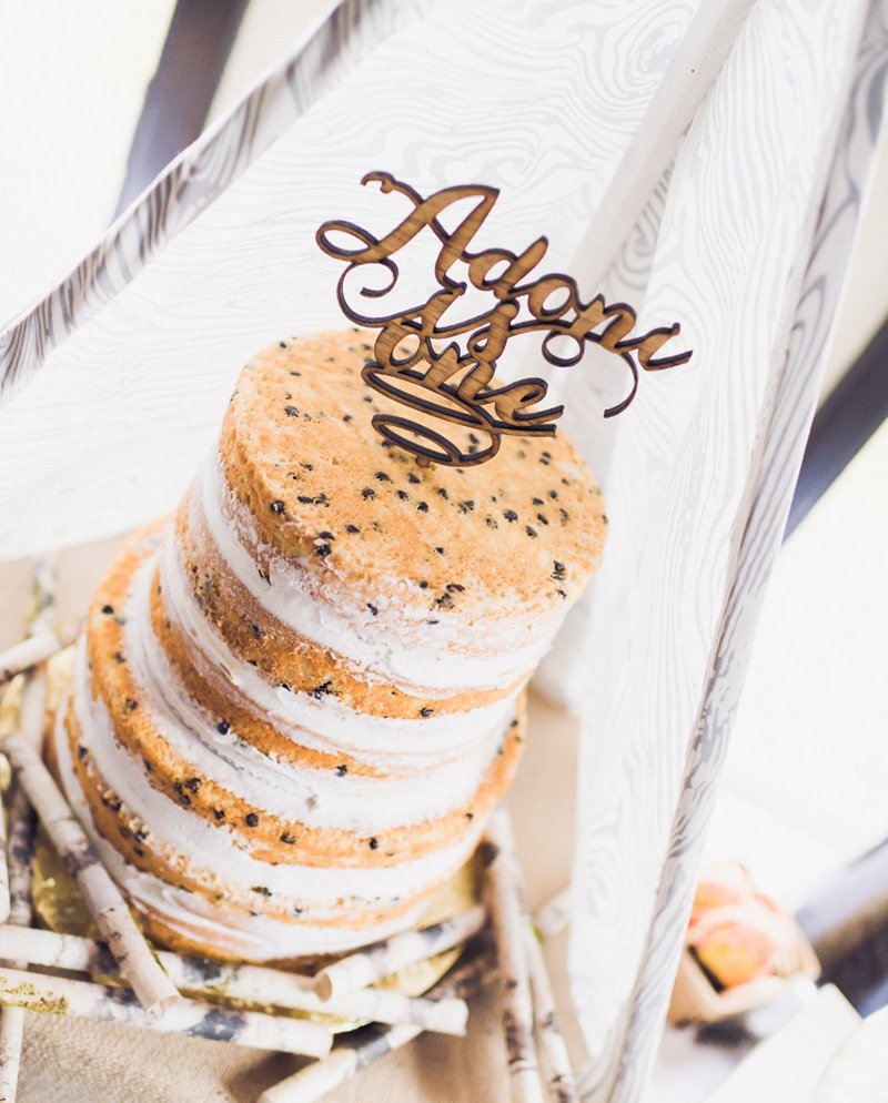 naked layer cake with personalized wood cut out cake topper