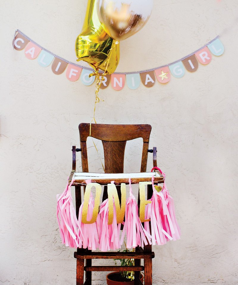 pink and gold first birthday high chair decorations