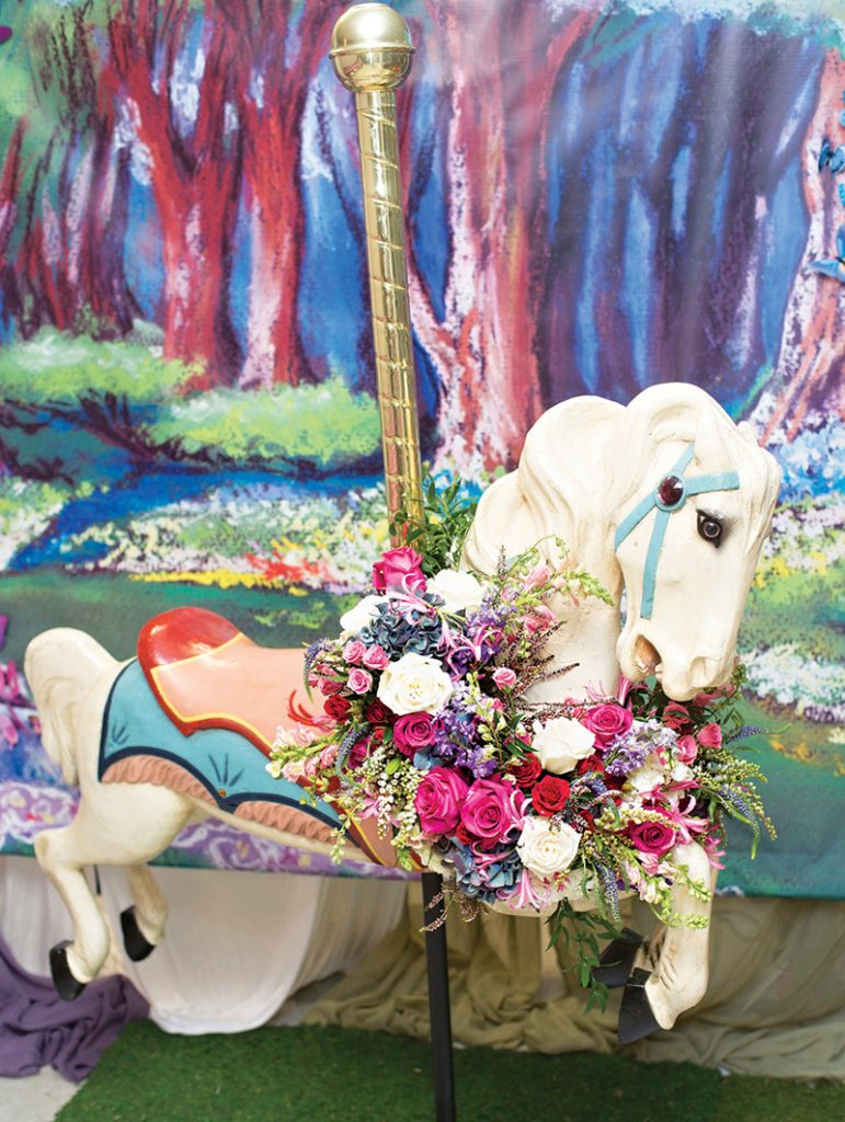 flower decorated carousel horse