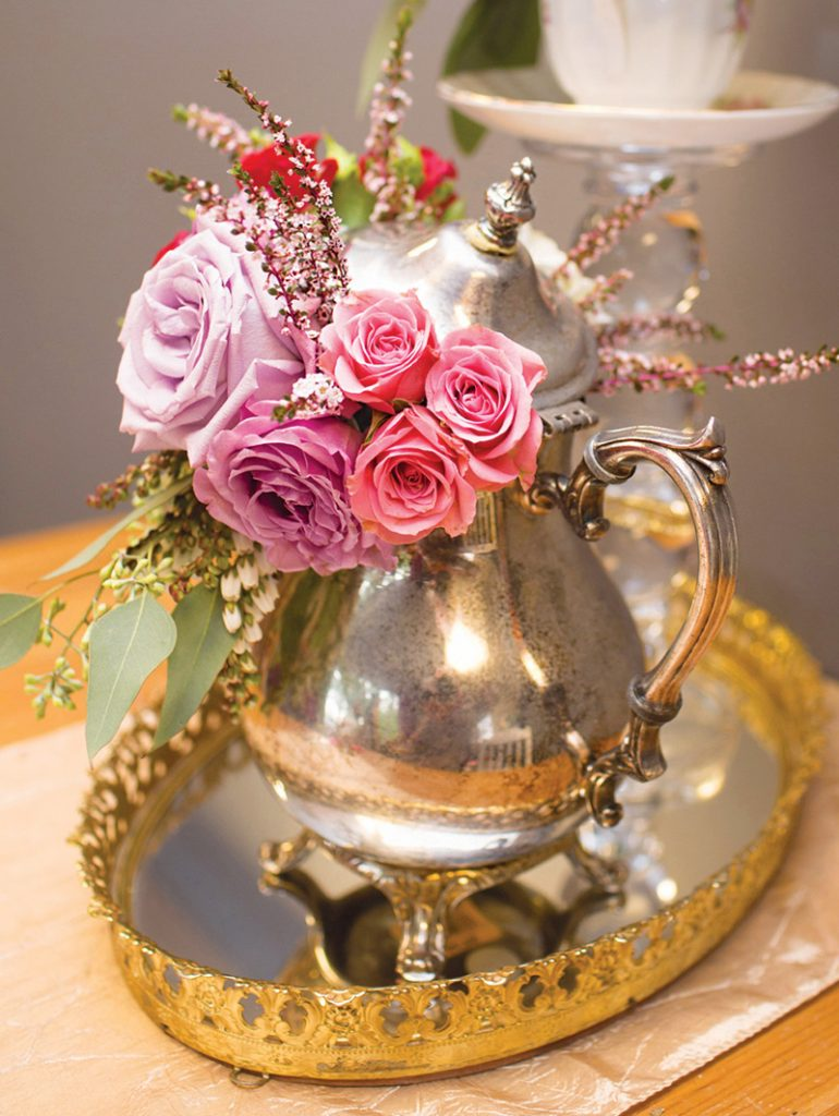 flower filled teapots as party decor