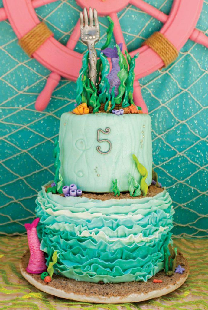 fork topped little mermaid birthday cake